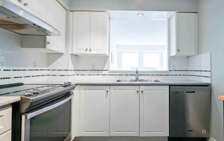 Kitchen featured at 304 – 60 Old Mill Road, Oakville at Alex Irish & Associates