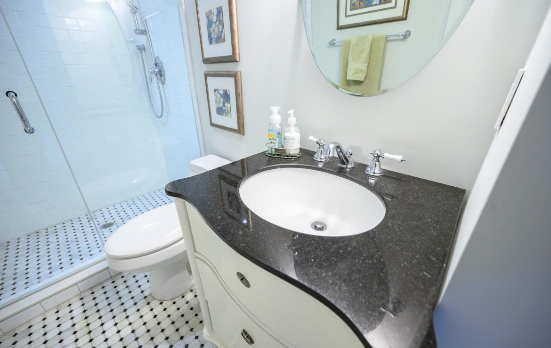 Bathroom featured at 199 Allan Street, Old Oakville, ON at Alex Irish & Associates