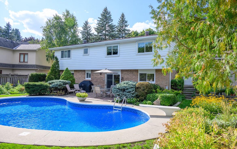 Swimming pool featured at 1466 Bunsden Avenue, Mississauga, ON at Alex Irish & Associates