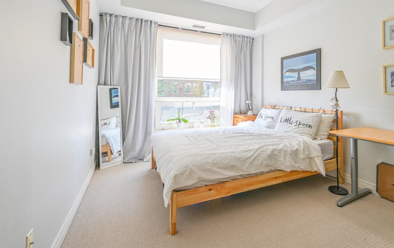 Bedroom featured at 304 – 60 Old Mill Road, Oakville at Alex Irish & Associates