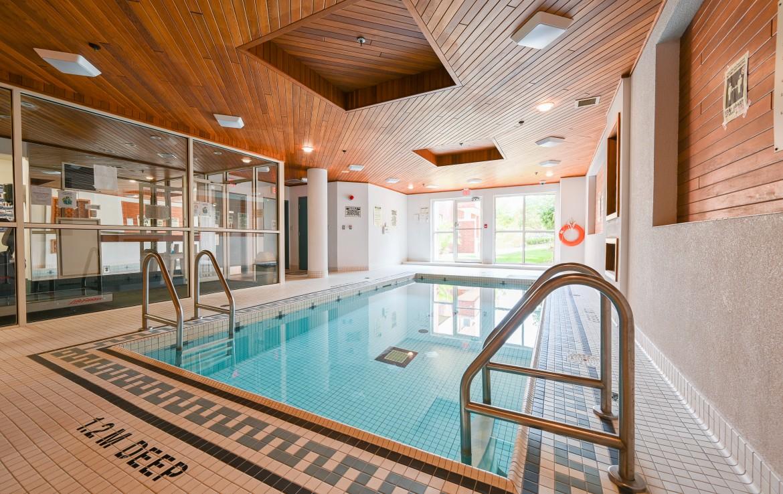 Swimming pool featured at 304 – 60 Old Mill Road, Oakville at Alex Irish & Associates