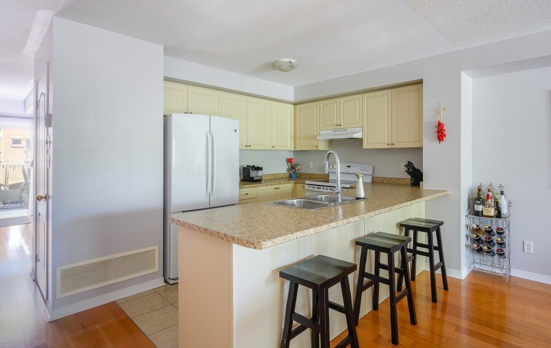 Kitchen featured at 10 – 3355 Thomas Street, Mississauga, ON at Alex Irish & Associates