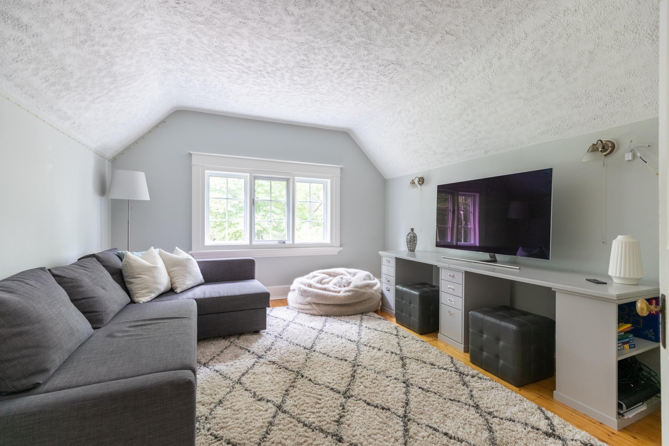 Living room featured at 573 Lakeshore Road West, Oakville, ON at Alex Irish & Associates