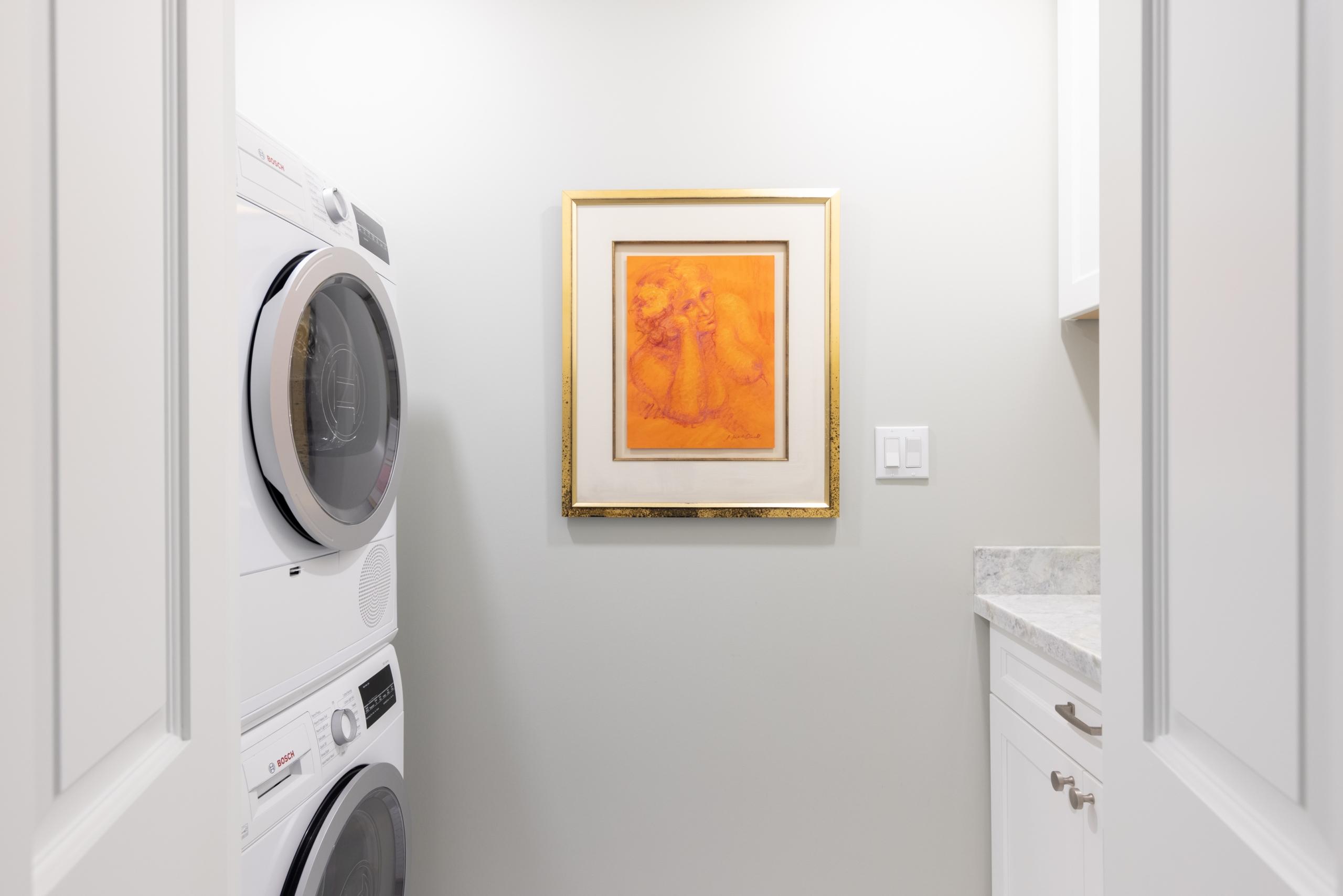 Laundry room featured at 295 William Street, Oakville. Alex Irish & Associates