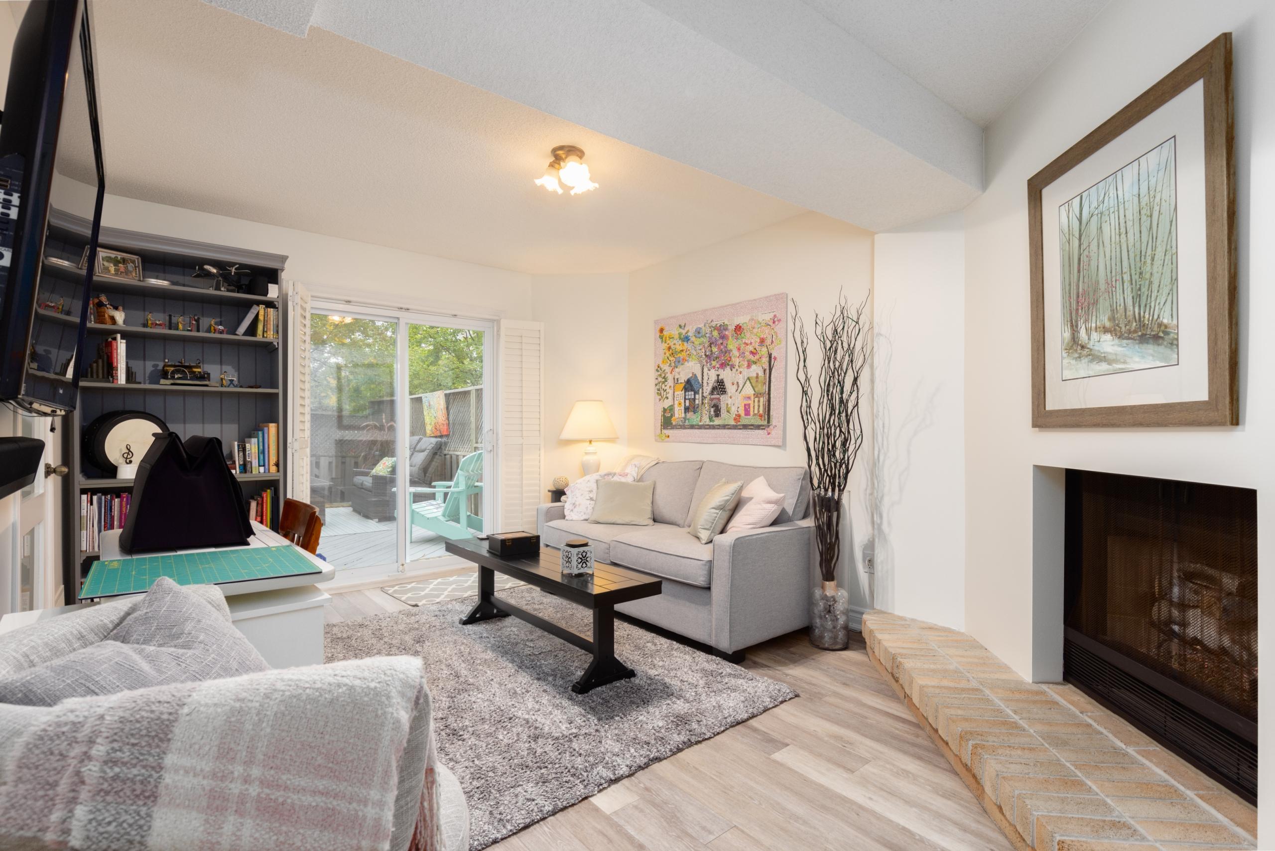 Living room featured at 16-2299 Marine Drive, Oakville, ON at Alex Irish & Associates